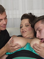 Huge breasted BBW doing two guys at once