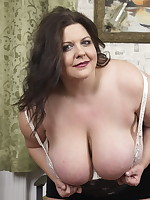 Huge breasted mature BBW playing around
